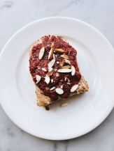 Linda's almond butter toast : bread SRSLY gluten-free bread, house-made almond butter, house-made raspberry chia jam with no added sugar.